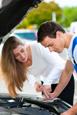 http://www.dreamstime.com/royalty-free-stock-photo-woman-talking-to-car-mechanic-repair-shop-image18353135