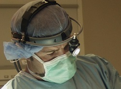 surgeon with headlamp