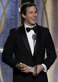Andy Samberg giving his speech, award in hand.