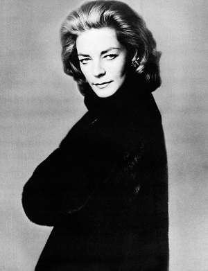 Lauren Bacall's shot for BLACKGLAMA. She wears a large, elegant black fur coat
