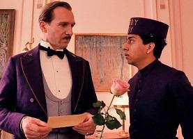 Fiennes and Revolori as Gustave H. and Zero Mustafa