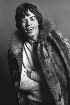 Mick Jagger joins in wearing this fur coat in a photoshoot