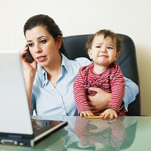 http://www.dreamstime.com/royalty-free-stock-image-businesswoman-phone-holding-daughter-image13017866
