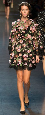 Dolce & Gabbana Spring Ready to Wear 2014 with a knockout combo of lace, sheer dress, and a bustier underneath