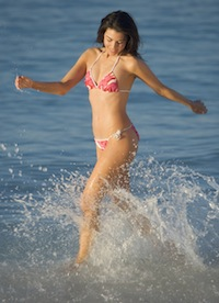 Woman Running in Surf