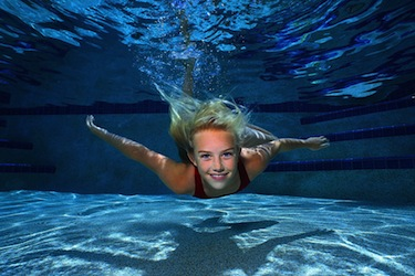 Young Girl Swimming in Pureion chemical free pool water