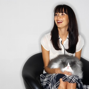 Woman Sitting with a Cat in Her Lap
