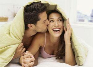 cuddling.couple.smile.