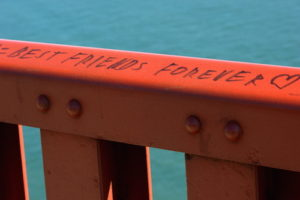 "Guard rail along the east sidewalk of the Golden Gate Bridge in San Francisco, California. A permanent marker inscription reads ""Best friends forever ♥""."