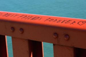 "Guard rail along the east sidewalk of the Golden Gate Bridge in San Francisco, California. A permanent marker inscription reads ""Best friends forever ♥""."