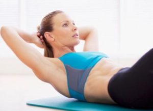 woman-crunches-gym-feature