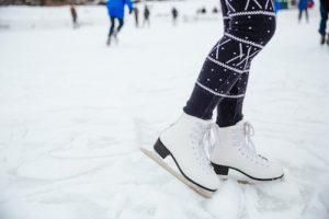 Female legs in ice skates